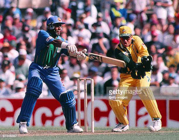 Hashan Tillakaratne of Sri Lanka bats as Ian Healy of Australia keeps wicket during a one day international match between Sri Lanka and Australia