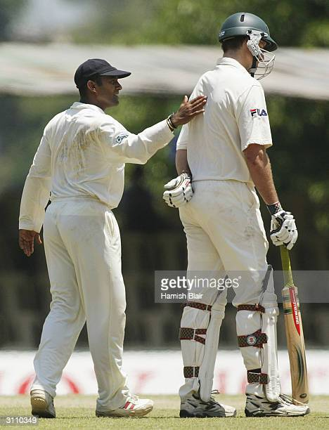 Hashan Tillakaratne of Sri Lanka exchanges words with Michael Kasprowicz of Australia after a disputed catch resulted in Kasprowicz being ruled not...