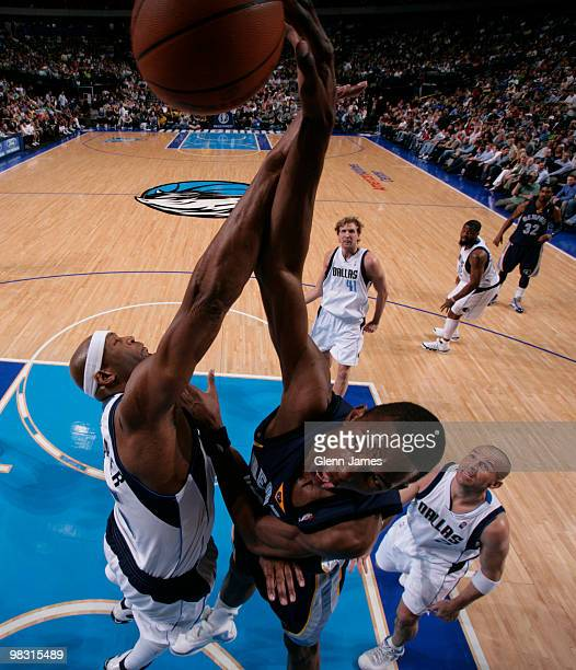 Hasheem Thabeet of the Memphis Grizzlies goes up for the dunk against Erick Dampier of the Dallas Mavericks during a game at the American Airlines...