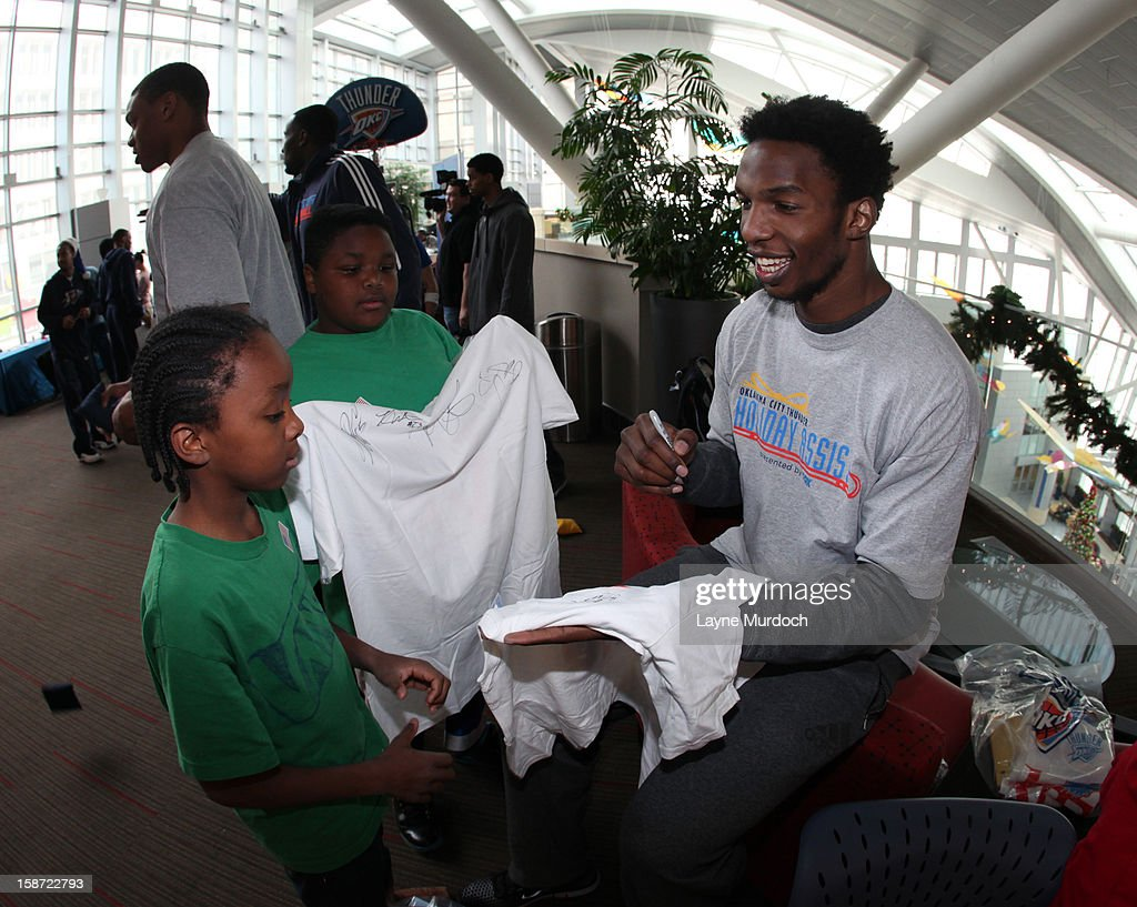 Hasheem Thabeet #34 of the Oklahoma City Thunder along with the rest of the team, visits patients in the Children's Hospital on December 22, 2012 in Oklahoma City, Oklahoma.