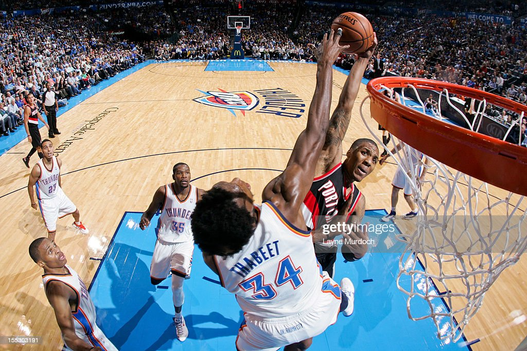 <a gi-track='captionPersonalityLinkClicked' href=/galleries/search?phrase=Hasheem+Thabeet&family=editorial&specificpeople=4003778 ng-click='$event.stopPropagation()'>Hasheem Thabeet</a> #34 of the Oklahoma City Thunder contests a shot attempt by <a gi-track='captionPersonalityLinkClicked' href=/galleries/search?phrase=Damian+Lillard&family=editorial&specificpeople=6598327 ng-click='$event.stopPropagation()'>Damian Lillard</a> #0 of the Portland Trail Blazers on November 2, 2012 at the Chesapeake Energy Arena in Oklahoma City, Oklahoma.