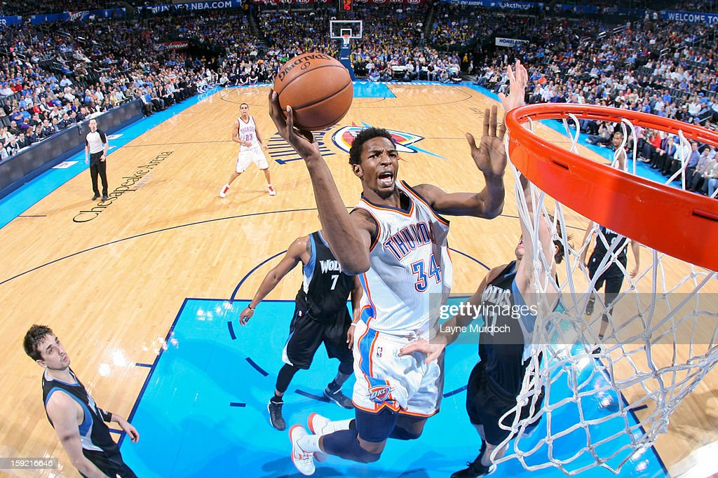 Hasheem Thabeet #34 of the Oklahoma City Thunder drives to the basket against Lou Amundson #17 of the Minnesota Timberwolves on January 9, 2013 at the Chesapeake Energy Arena in Oklahoma City, Oklahoma.