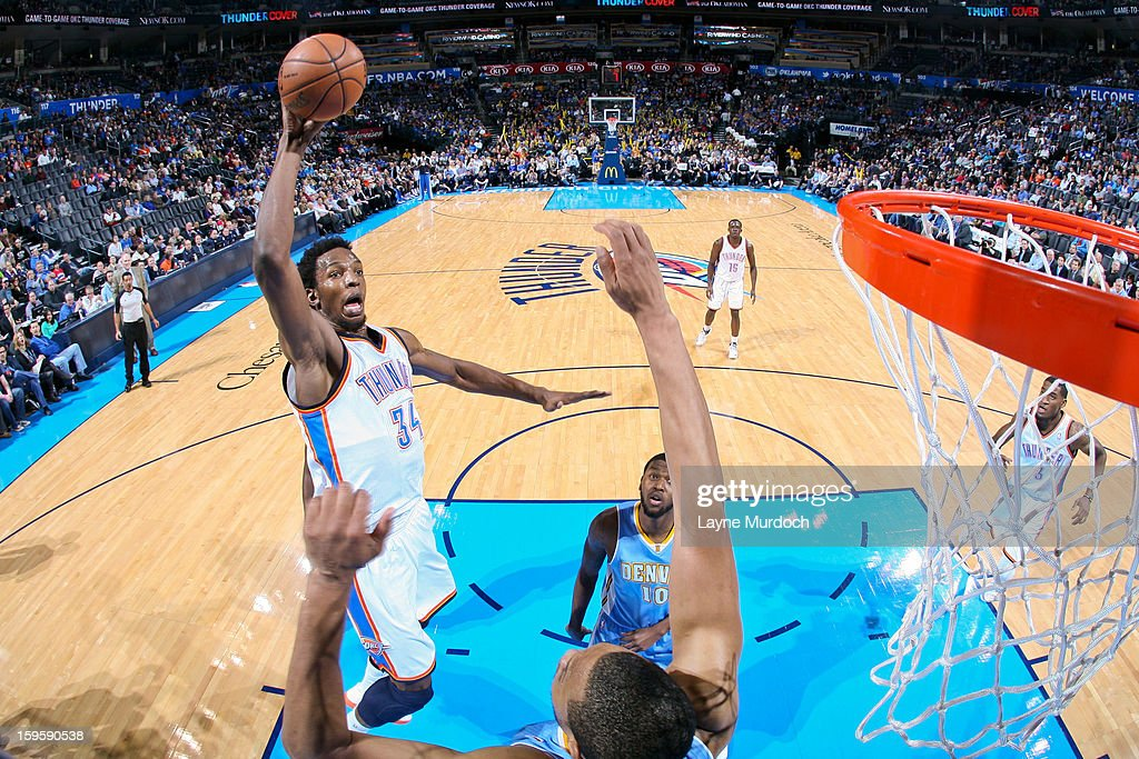 Hasheem Thabeet #34 of the Oklahoma City Thunder drives to the basket against the Denver Nuggets on January 16, 2013 at the Chesapeake Energy Arena in Oklahoma City, Oklahoma.