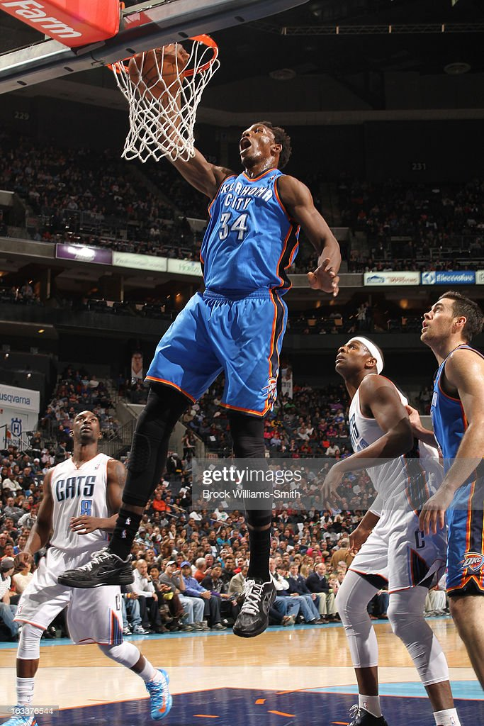 Hasheem Thabeet #34 of the Oklahoma City Thunder dunks against Brendan Haywood #3 and the Charlotte Bobcats at the Time Warner Cable Arena on March 8, 2013 in Charlotte, North Carolina.