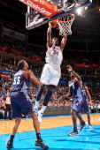 Hasheem Thabeet of the Oklahoma City Thunder dunks against Reggie Williams and DeSagana Diop of the Charlotte Bobcats on November 26 2012 at the...