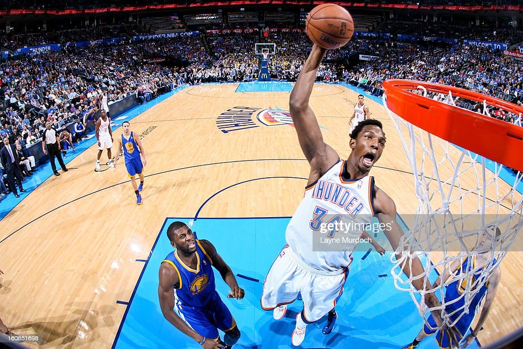 <a gi-track='captionPersonalityLinkClicked' href=/galleries/search?phrase=Hasheem+Thabeet&family=editorial&specificpeople=4003778 ng-click='$event.stopPropagation()'>Hasheem Thabeet</a> #34 of the Oklahoma City Thunder dunks against the Golden State Warriors on February 6, 2013 at the Chesapeake Energy Arena in Oklahoma City, Oklahoma.