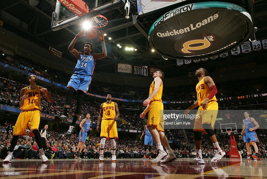 Hasheem Thabeet of the Oklahoma City Thunder dunks the ball while surrounded by Shaun Livingston CJ Miles Tyler Zeller and Wayne Ellington of the...