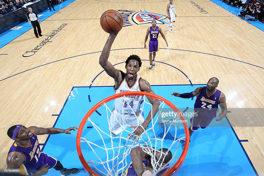 Hasheem Thabeet #34 of the Oklahoma City Thunder goes in for the dunk against the Los Angeles Lakers during an NBA game on December 7, 2012 at the Chesapeake Energy Arena in Oklahoma City, Oklahoma.