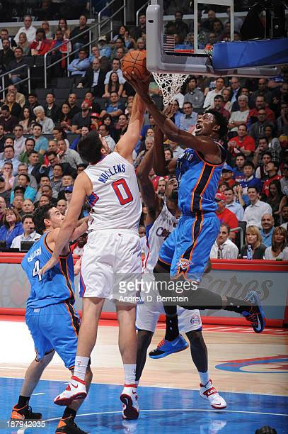 Hasheem Thabeet of the Oklahoma City Thunder goes up for a shot against Byron Mullens of the Los Angeles Clippers at Staples Center on November 13...