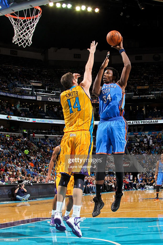 Hasheem Thabeet #34 of the Oklahoma City Thunder shoots against Jason Smith #14 of the New Orleans Hornets on November 16, 2012 at the New Orleans Arena in New Orleans, Louisiana.