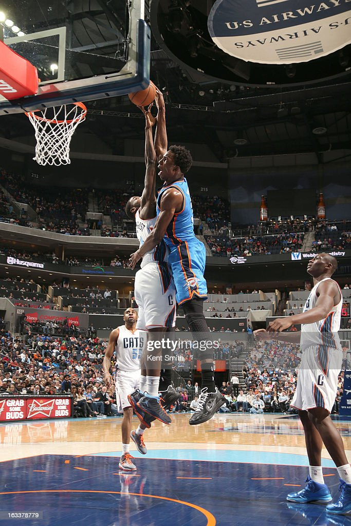 Hasheem Thabeet #34 of the Oklahoma City Thunder shoots against Michael Kidd-Gilchrist #14 of the Charlotte Bobcats at the Time Warner Cable Arena on March 8, 2013 in Charlotte, North Carolina.