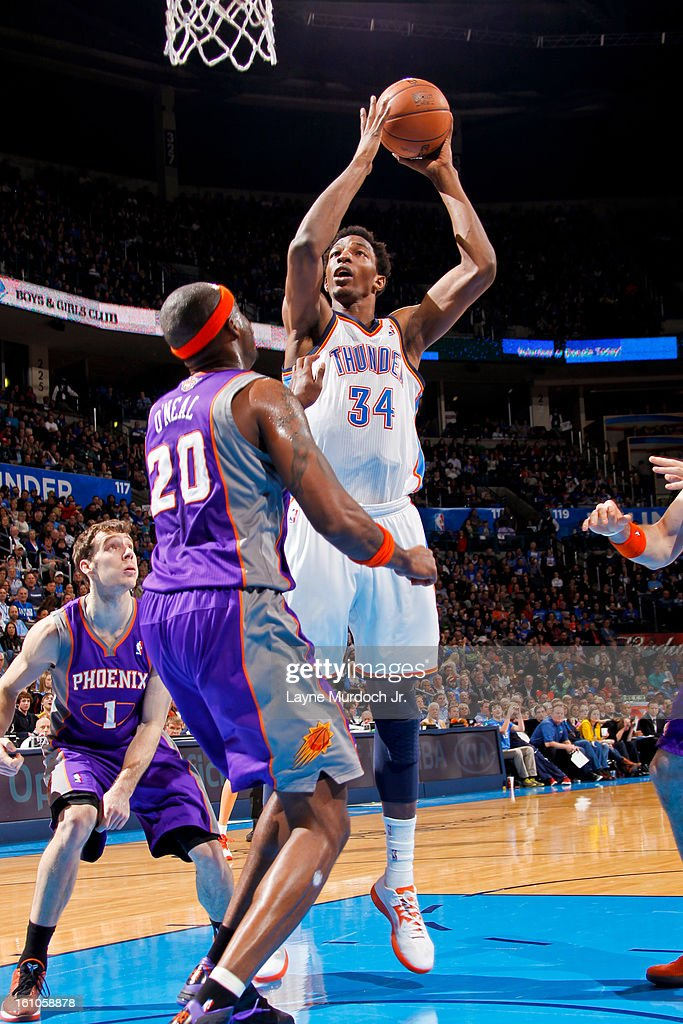 Hasheem Thabeet #34 of the Oklahoma City Thunder shoots in the lane against Jermaine O'Neal #20 of the Phoenix Suns on February 8, 2013 at the Chesapeake Energy Arena in Oklahoma City, Oklahoma.