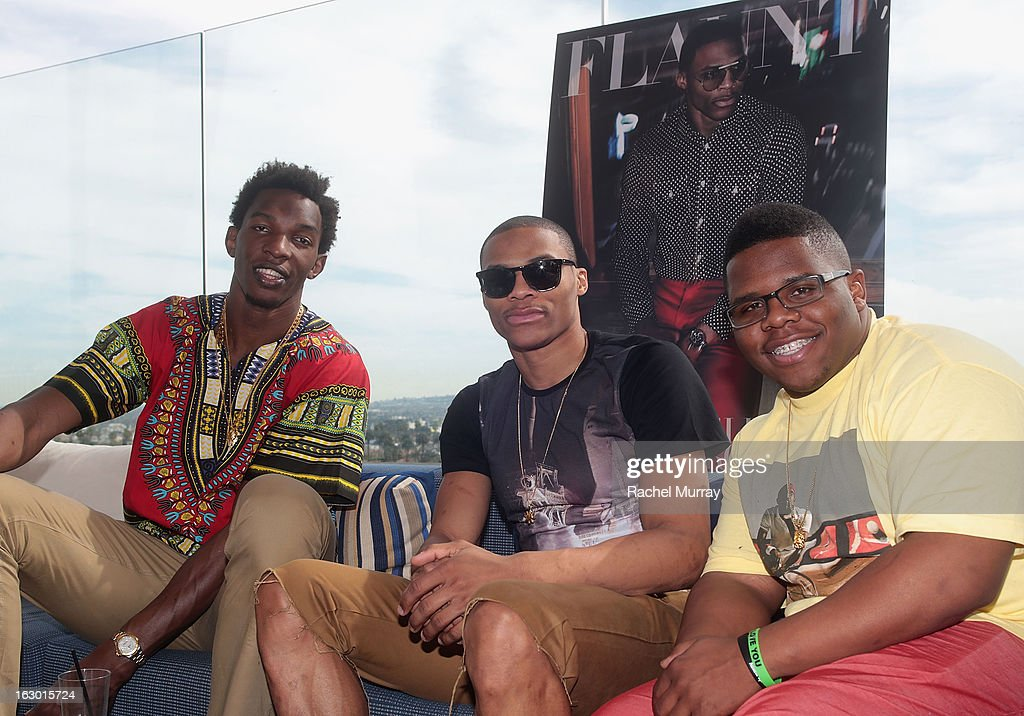 Hasheem Thabeet, Russell Westbrook, and Ray Westbrook attend Flaunt Magazine and Samsung Galaxy celebrate The Plutocracy Issue release hosted by cover Russell Westbrook at Caulfield's Bar and Dining Room at Thompson Hotel on March 2, 2013 in Beverly Hills, California.