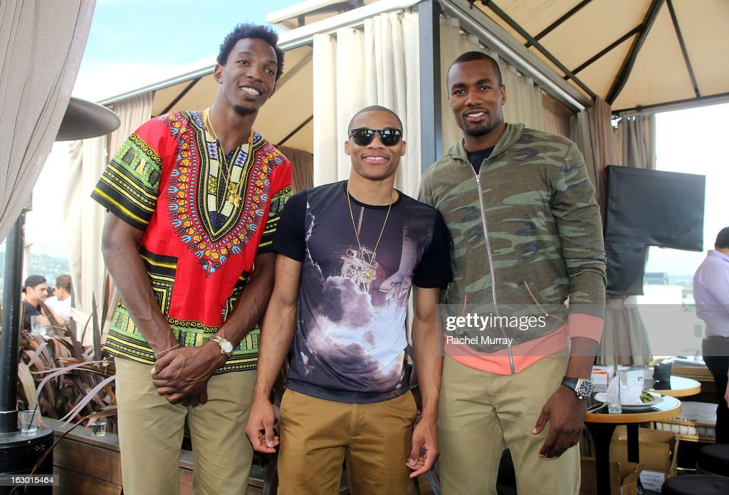 Hasheem Thabeet, Russell Westbrook, and Serge Ibaka attend Flaunt Magazine and Samsung Galaxy celebrate The Plutocracy Issue release hosted by cover Russell Westbrook at Caulfield's Bar and Dining Room at Thompson Hotel on March 2, 2013 in Beverly Hills, California.