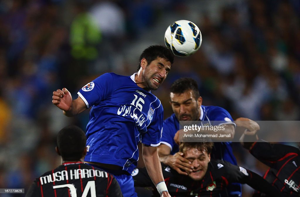 Hashem Beykzadeh and Hanif Omranzadeh of Esteghlal in Action during the AFC Champions League Group D match between Esteghlal and Al Rayyan at Azadi Stadium on April 23, 2013 in Tehran, Iran.