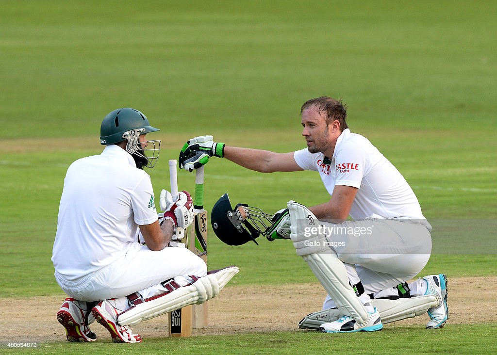 Hashim Amla and AB de Villiers during day 1 of the 1st Test match between South Africa and West Indies at SuperSport Park on December 17, 2014 in Pretoria, South Africa.