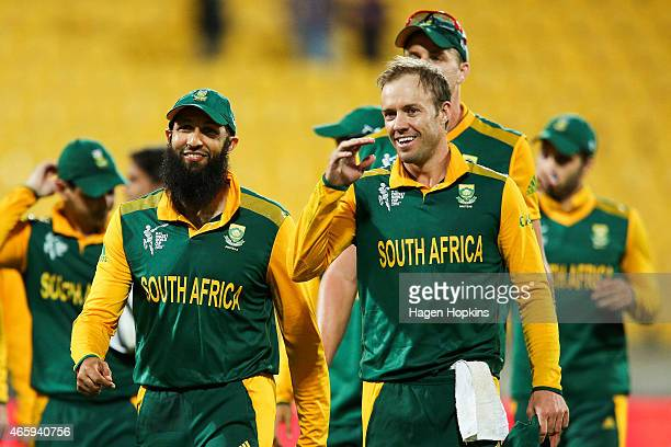 Hashim Amla and AB de Villiers of South Africa are all smiles after winning the 2015 ICC Cricket World Cup match between South Africa and the United...
