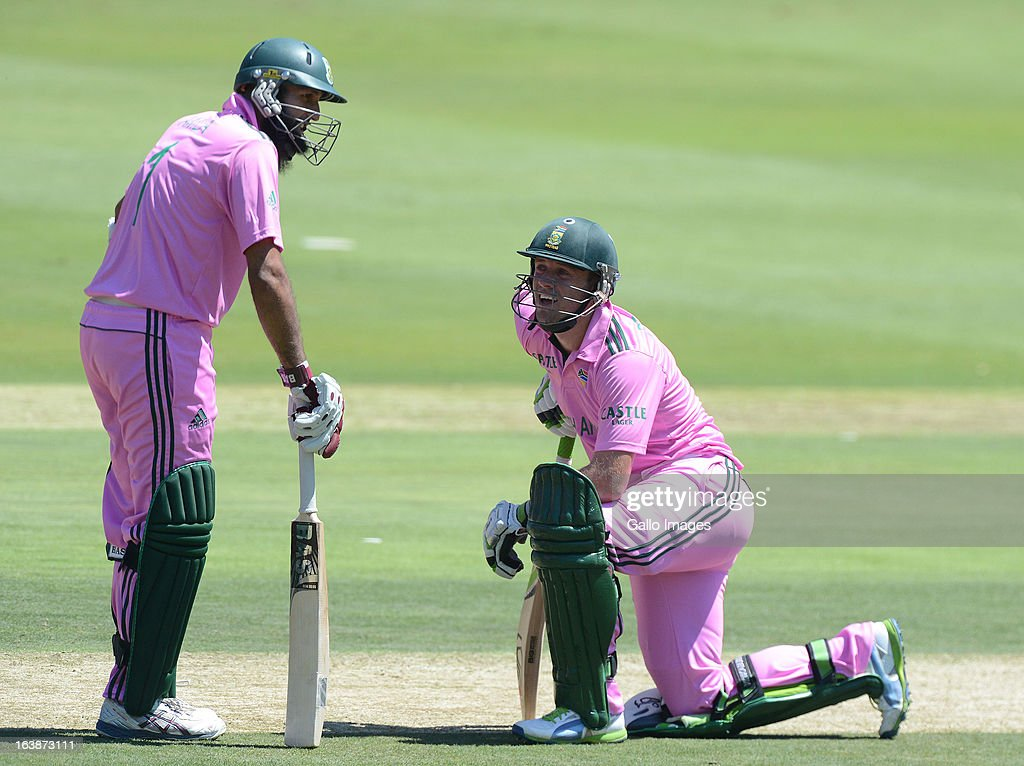 <a gi-track='captionPersonalityLinkClicked' href=/galleries/search?phrase=Hashim+Amla&family=editorial&specificpeople=647392 ng-click='$event.stopPropagation()'>Hashim Amla</a> and AB de Villiers of South Africa build their partnership to over a hundred during the 3rd Momentum ODI match between South Africa and Pakistan at Bidvest Wanderers Stadium on March 17, 2013 in Johannesburg, South Africa.