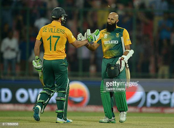 Hashim Amla and AB de Villiers of South Africa celebrate winning the ICC World Twenty20 India 2016 Group 1 match between South Africa and Sri Lanka...