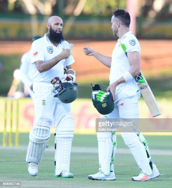 Hashim Amla and Faf du Plessis of the Proteas during day 1 of the 2nd Sunfoil Test match between South Africa and Bangladesh at Mangaung Oval on...