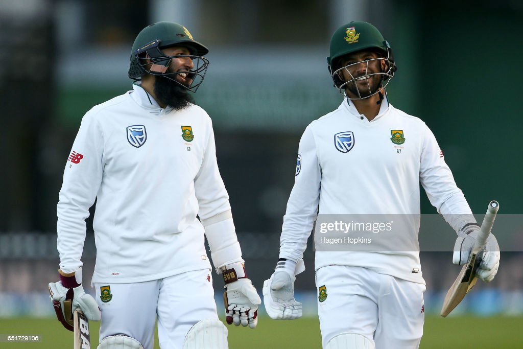 Hashim Amla and JP Duminy of South Africa celebrate the win during day three of the test match between New Zealand and South Africa at Basin Reserve on March 18, 2017 in Wellington, New Zealand.