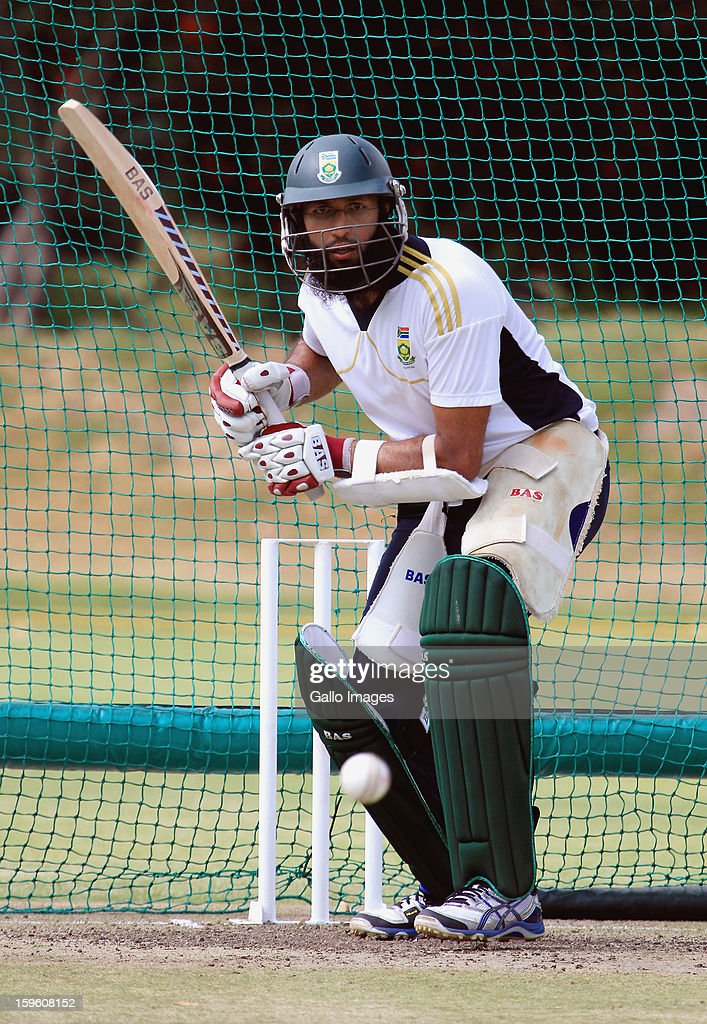 Hashim Amla bats during the South African national cricket team nets session and press conference at Claremont Cricket Club on January 17, 2013 in Cape Town, South Africa.