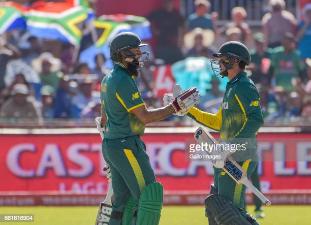 Hashim Amla congratulating Quinton de Kock of South Africa on his 50 runs during the 1st Momentum ODI match between South Africa and Bangladesh at...
