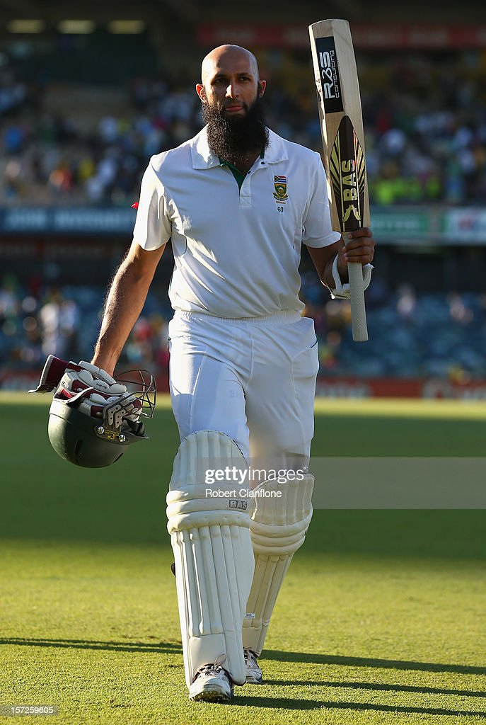 <a gi-track='captionPersonalityLinkClicked' href=/galleries/search?phrase=Hashim+Amla&family=editorial&specificpeople=647392 ng-click='$event.stopPropagation()'>Hashim Amla</a> of South Africa acknowledges the crowd as he walks from the ground after he finished the day on 99 not out on day two of the Third Test Match between Australia and South Africa at WACA on December 1, 2012 in Perth, Australia.