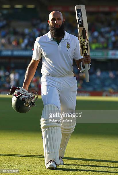 Hashim Amla of South Africa acknowledges the crowd as he walks from the ground after he finished the day on 99 not out on day two of the Third Test...