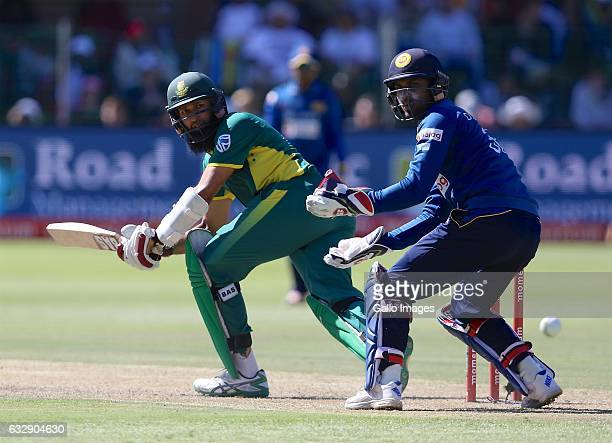 Hashim Amla of South Africa and Dinesh Chandimal of Sri Lanka during the 1st One Day International match between South Africa and Sri Lanka at St...