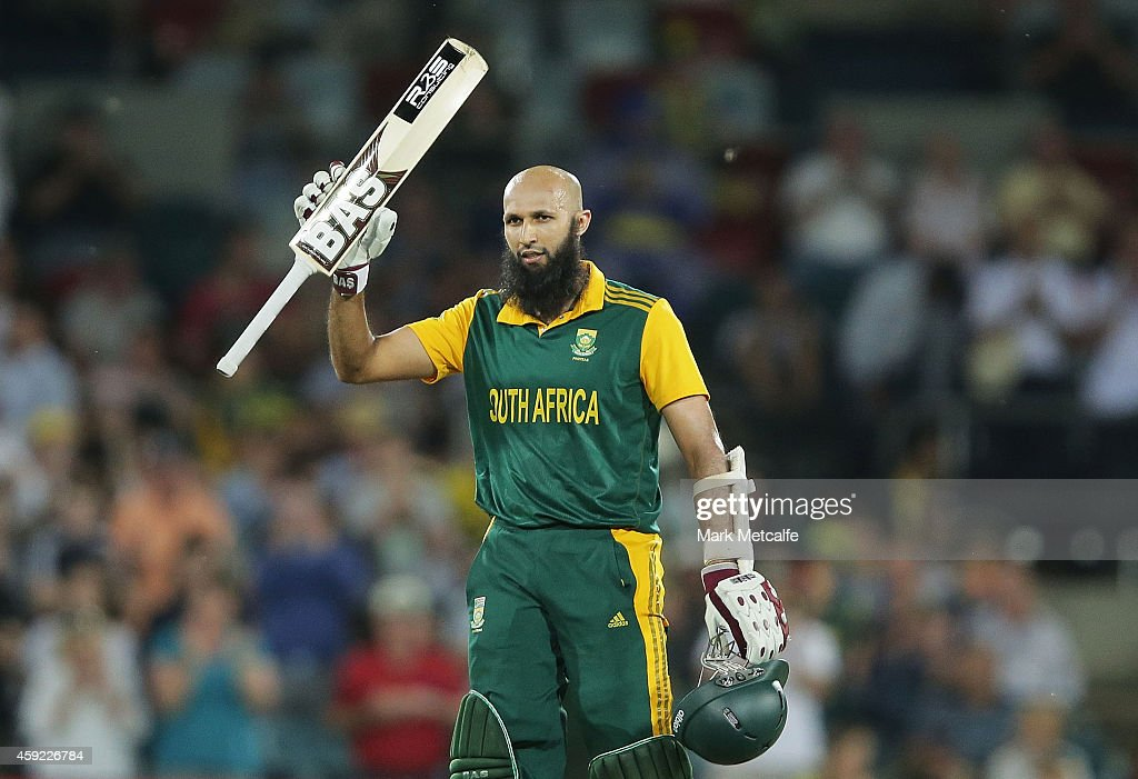 Hashim Amla of South Africa celebrates and acknowledges the crowd after scoring a century during game three of the One Day International Series between Australia and South Africa at Manuka Oval on November 19, 2014 in Canberra, Australia.