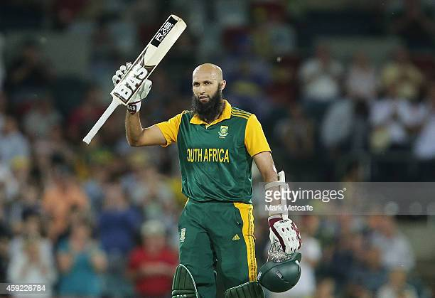 Hashim Amla of South Africa celebrates and acknowledges the crowd after scoring a century during game three of the One Day International Series...