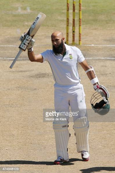 Hashim Amla of South Africa celebrates getting 100 runs during day four of the Second Test match between South Africa and Australia at AXXESS St...