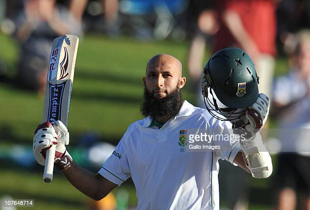 AFRICA DECEMBER 17 Hashim Amla of South Africa celebrates his 100 runs during day 2 of the 1st Test match between South Africa and India at...