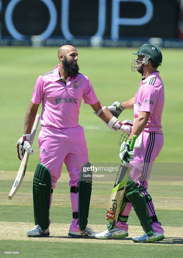 <a gi-track='captionPersonalityLinkClicked' href=/galleries/search?phrase=Hashim+Amla&family=editorial&specificpeople=647392 ng-click='$event.stopPropagation()'>Hashim Amla</a> of South Africa celebrates his 100 with AB de Villiers during the 3rd Momentum ODI match between South Africa and Pakistan at Bidvest Wanderers Stadium on March 17, 2013 in Johannesburg, South Africa.