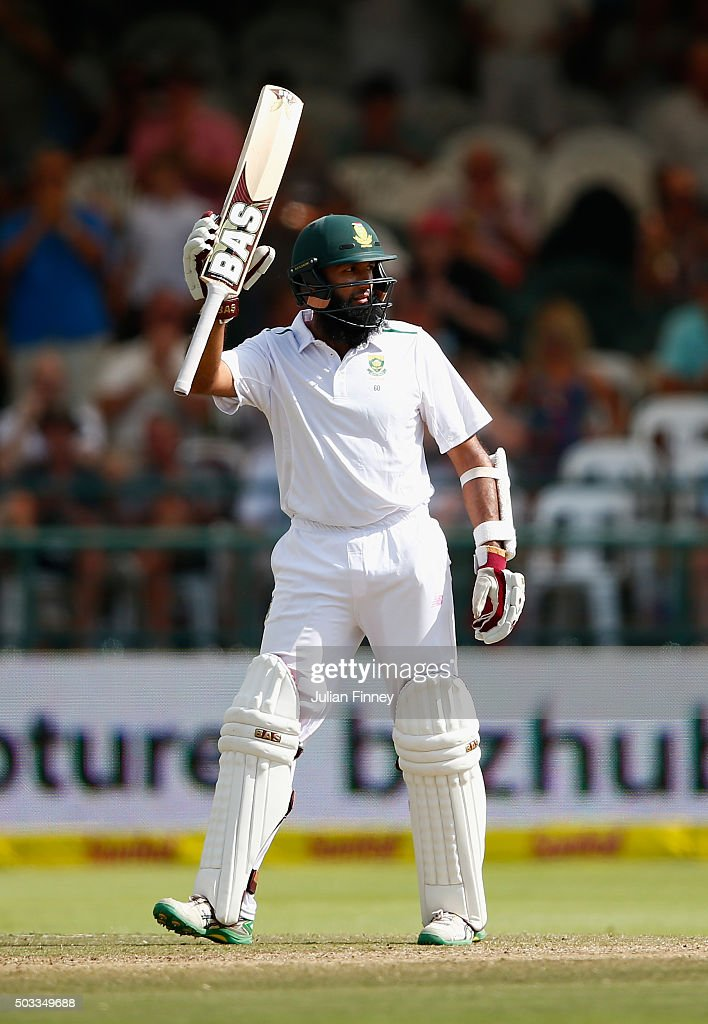 <a gi-track='captionPersonalityLinkClicked' href=/galleries/search?phrase=Hashim+Amla&family=editorial&specificpeople=647392 ng-click='$event.stopPropagation()'>Hashim Amla</a> of South Africa celebrates his 150 runs during day three of the 2nd Test at Newlands Stadium on January 4, 2016 in Cape Town, South Africa.