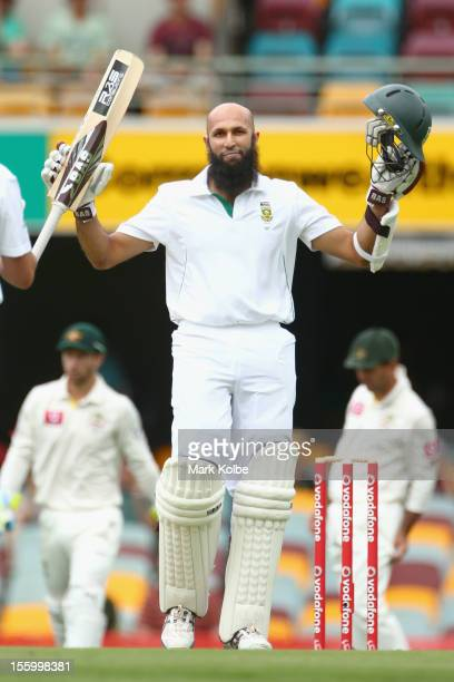 Hashim Amla of South Africa celebrates his century during day three of the First Test match between Australia and South Africa at The Gabba on...