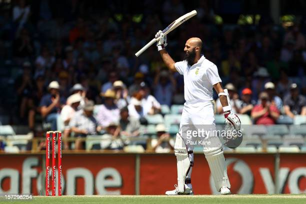 Hashim Amla of South Africa celebrates his century during day three of the Third Test Match between Australia and South Africa at WACA on December 2...