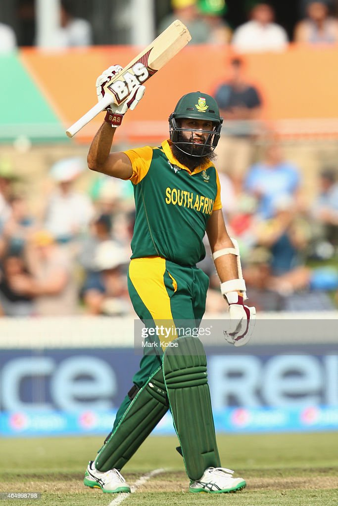 <a gi-track='captionPersonalityLinkClicked' href=/galleries/search?phrase=Hashim+Amla&family=editorial&specificpeople=647392 ng-click='$event.stopPropagation()'>Hashim Amla</a> of South Africa celebrates his century during the 2015 ICC Cricket World Cup match between South Africa and Ireland at Manuka Oval on March 3, 2015 in Canberra, Australia.