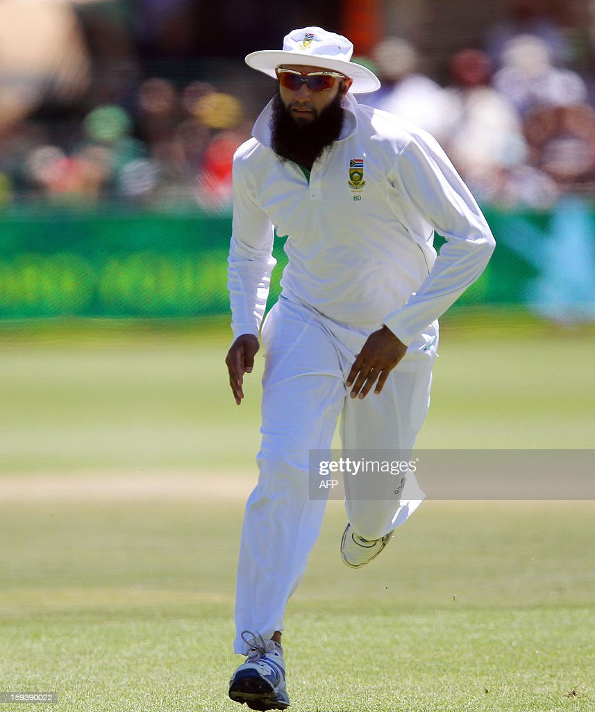 Hashim Amla of South Africa chases the ball on the third day of the second and final test match between South Africa and New Zealand at the Axxess St George's Cricket Stadium on January 13, 2013 in Port Elizabeth. AFP Photo / Anesh Debiky
