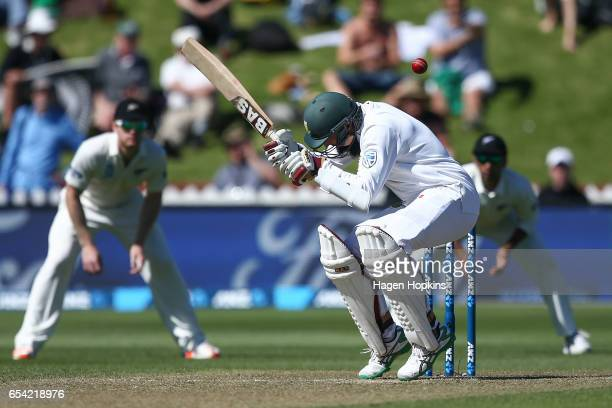 Hashim Amla of South Africa ducks under a bouncer during day two of the test match between New Zealand and South Africa at Basin Reserve on March 17...