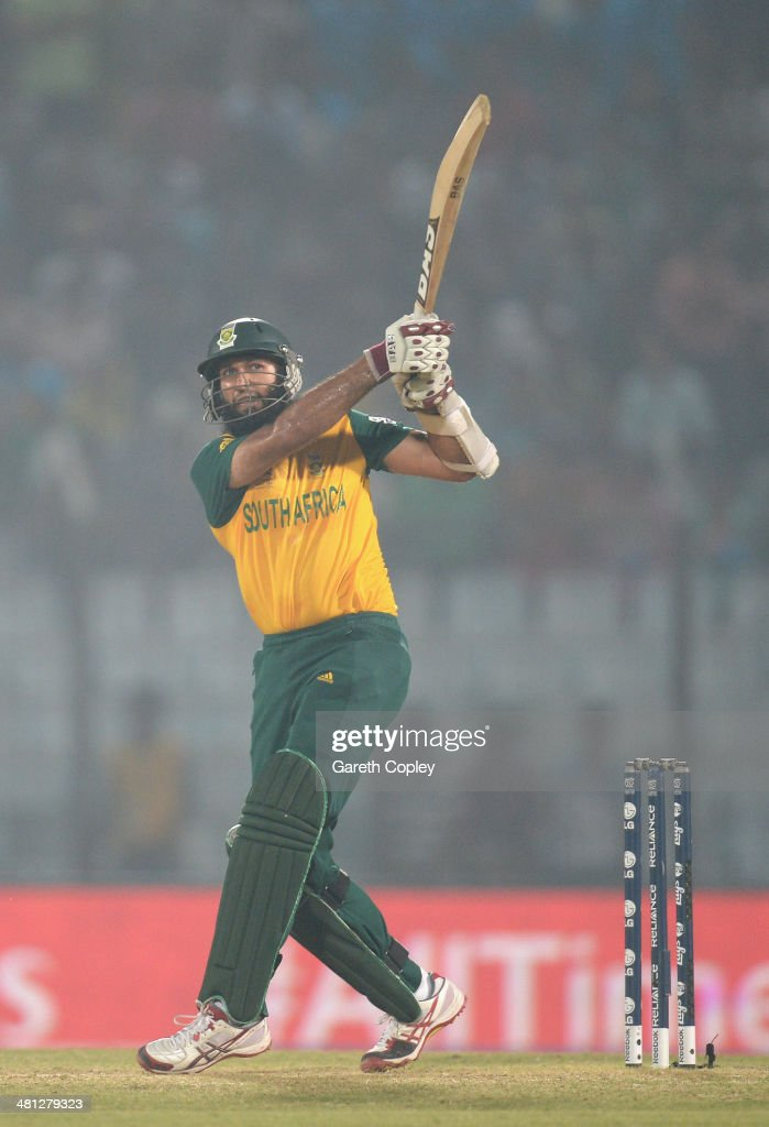 Hashim Amla of South Africa hits out for six runs during the ICC World Twenty20 Bangladesh 2014 Group 1 match between England and South Africa at Zahur Ahmed Chowdhury Stadium on March 29, 2014 in Chittagong, Bangladesh.