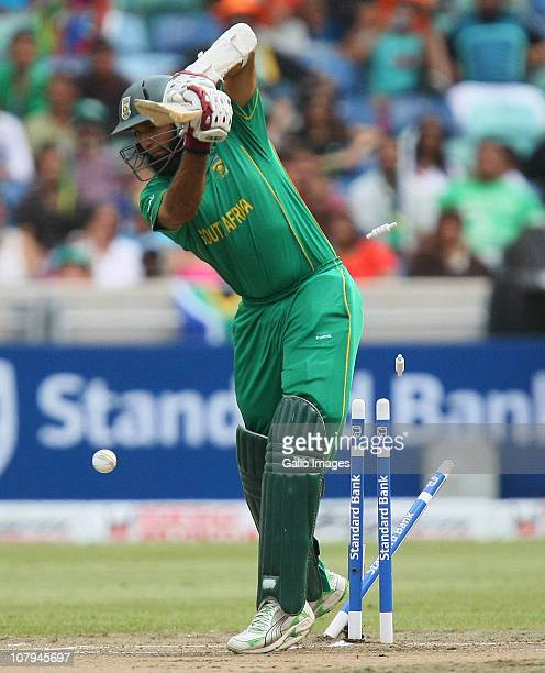 Hashim Amla of South Africa is bowled by Ashish Nehra of India during the Standard Bank Pro20 international match between South Africa and India at...