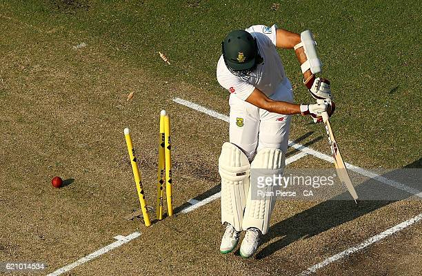 Hashim Amla of South Africa is bowled by Josh Hazlewood of Australia during day two of the First Test match between Australia and South Africa at...