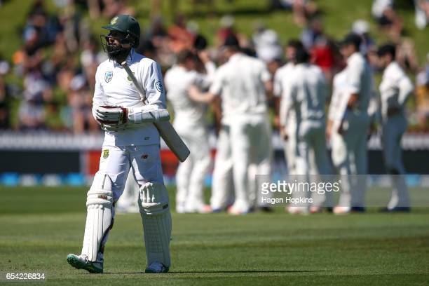 Hashim Amla of South Africa leaves the field after being dismissed during day two of the test match between New Zealand and South Africa at Basin...