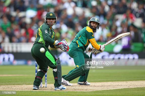 Hashim Amla of South Africa looks back at the ball alongside wicketkeeper Kamran Akmal of Pakistan during the ICC Champions Trophy Group B match...