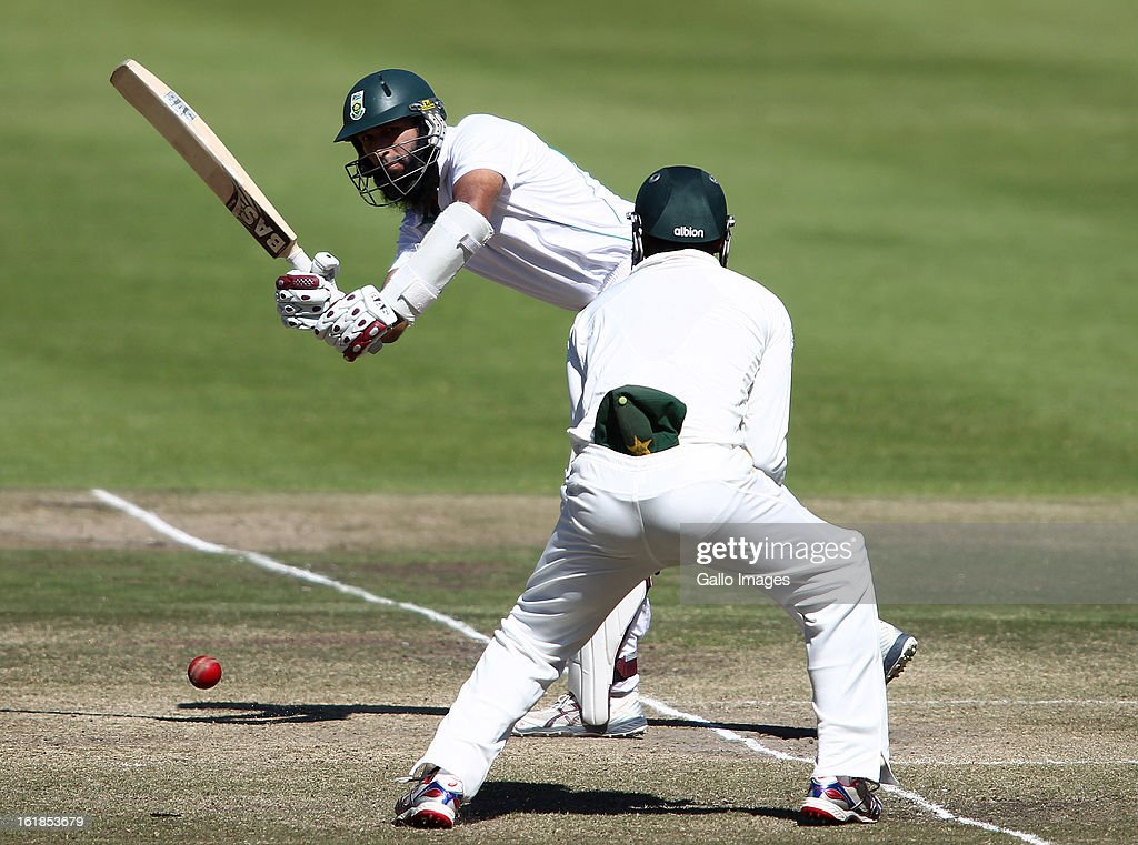 Hashim Amla of South Africa plays a delivery past short leg during day 4 of the 2nd Sunfoil Test match between South Africa and Pakistan at Sahara Park Newlands on February 17, 2013 in Cape Town, South Africa.