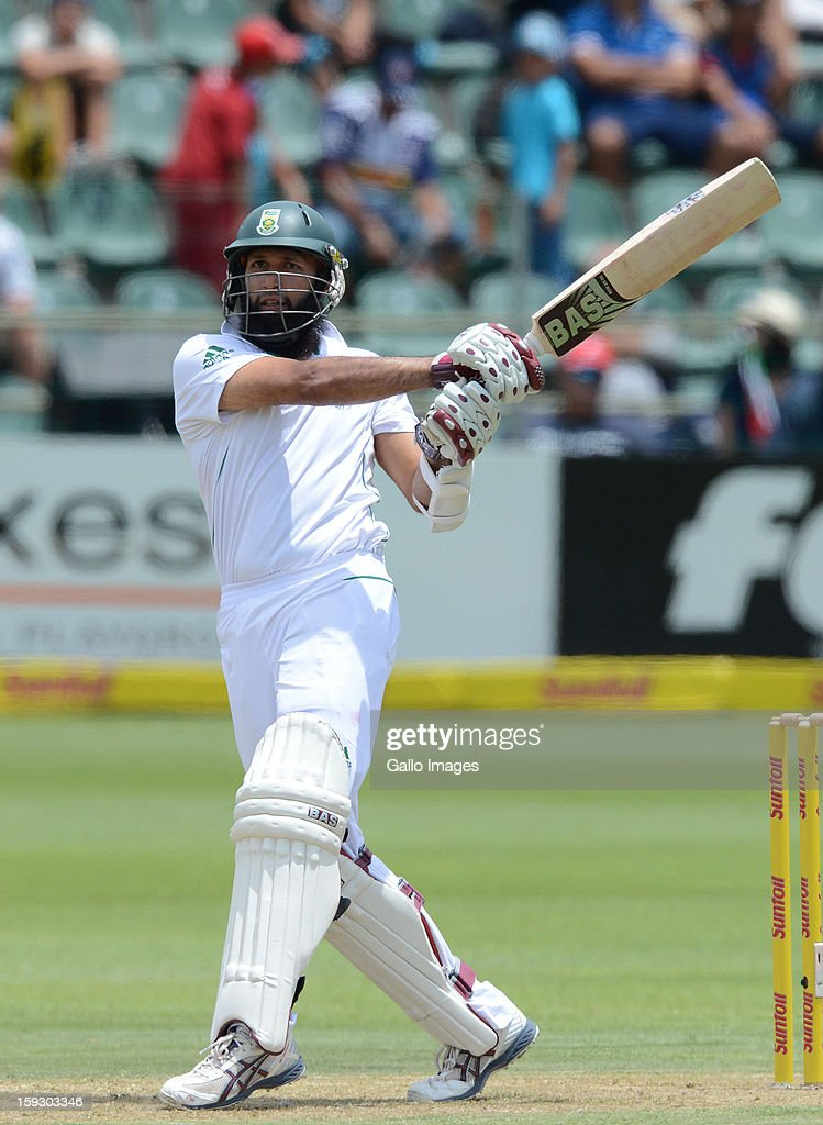 Hashim Amla of South Africa pulls a delivery to the boundary during day one of the second test match between South Africa and New Zealand at Axxess St Georges on January 11, 2013 in Port Elizabeth, South Africa.
