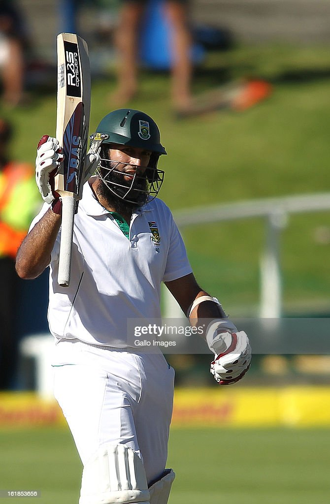 Hashim Amla of South Africa raises his bat after reaching his fifty during day 4 of the 2nd Sunfoil Test match between South Africa and Pakistan at Sahara Park Newlands on February 17, 2013 in Cape Town, South Africa.