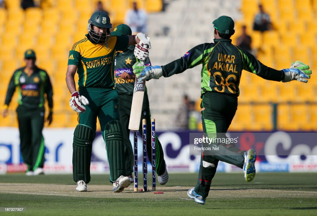 Hashim Amla of South Africa reacts after being dismissed by Pakistan bowler Mohammad Irfan during the third One Day International between Pakistan and South Africa at Sheikh Zayed Stadium on November 06, 2013 in Abu Dhabi, United Arab Emirates.